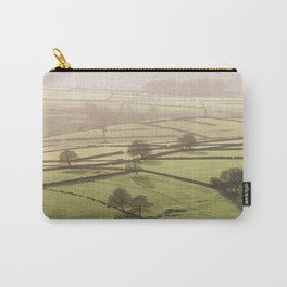 Hazy light at sunset over a valley of fields. Derbyshire, UK. Carry-All Pouch