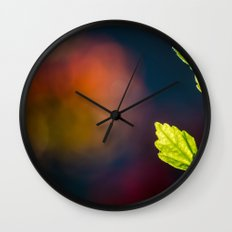 Leaves in a colorful world Wall Clock