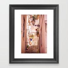 the narrow street in lisbon Framed Art Print