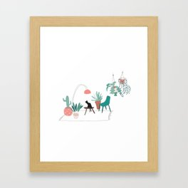 Cat relaxing in the living room among plants Framed Art Print