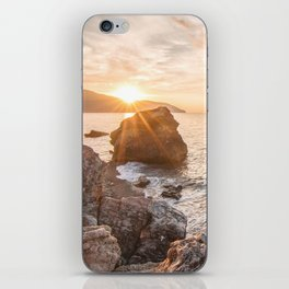 Rocky beach at sunset iPhone Skin