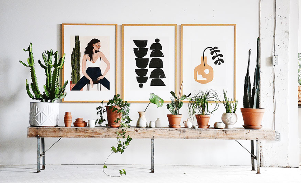 framed prints and sitting on bench with plants