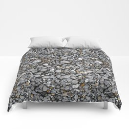 pebbles on the beach Comforters