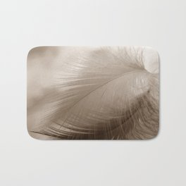 The feather hovers over the clouds Bath Mat
