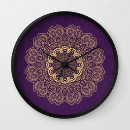 Golden Flower Mandala on Textured Purple Background Wall Clock