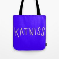katniss Tote Bags featuring Katniss by Annie Claire