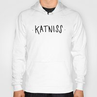 katniss Hoodies featuring Katniss by Annie Claire