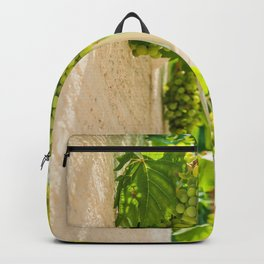 Bunch of grapes with green leaves in daylight Backpack