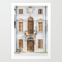 WHITE CONCRETE BUILDING WITH WOODEN DOORS AND WINDOWS Art Print