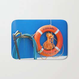 Life buoy hanging on a boat. Bath Mat