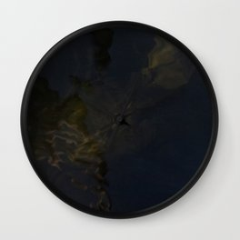 Water surface reflects the wooden pole together with surfacing algae. Wall Clock