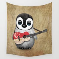 singapore Wall Tapestries featuring Baby Penguin Playing Singapore Flag Guitar by Jeff Bartels