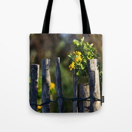 Yellow flower and wood fence Tote Bag