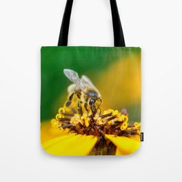 A bee on the flower Tote Bag