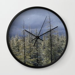 Snowing and sunny.Color.  At the same time at the mountains Wall Clock