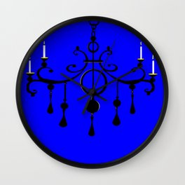 A Chandler with Candles and a Blue Background Wall Clock
