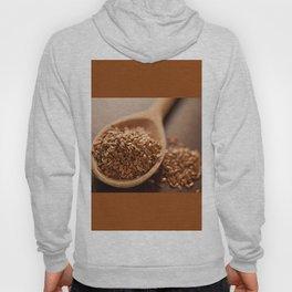 Brown flax seeds heap on wooden spoon Hoody