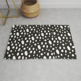 Bohemian Pebbles - Dark gray and cream dot pattern Rug