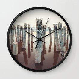 Pilings Clad in Winter Wall Clock