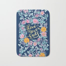 Love Never Fails -  1 Corinthians 13:8 (navy) Bath Mat