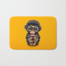 Cute Baby Chimp Reading a Book on Yellow Bath Mat