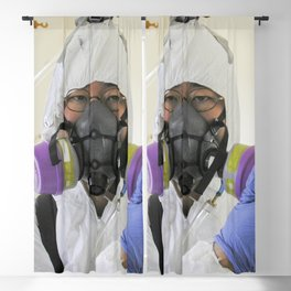 A healthcare worker investigating mold presence inside a home that had been flooded by Hurricane Kat Blackout Curtain