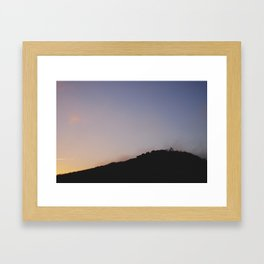 Male silhouetted on mountain top at sunset. Derbyshire, UK Framed Art Print