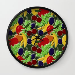 Different colorful juicy fruits on a green background Wall Clock