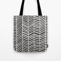 herringbone Tote Bags featuring Herringbone – Black & White by Cat Coquillette