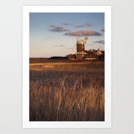 Reed beds at sunset with Cley Windmill beyond. Cley next the sea, North Norfolk Coast, UK Art Print