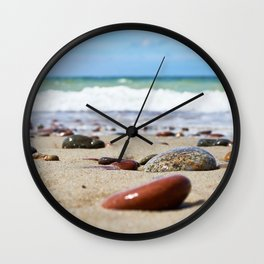 Colorful stones on sand beach Wall Clock