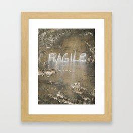 Fragile city Framed Art Print
