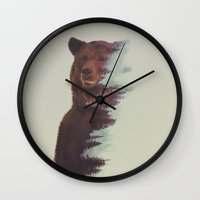andreas preis Wall Clocks featuring Observing Bear by Andreas Lie