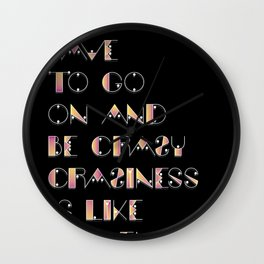 Craziness is like heaven Wall Clock