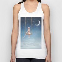toddler Tank Tops featuring The lovely girl shakes on a swing by natalia.maroz