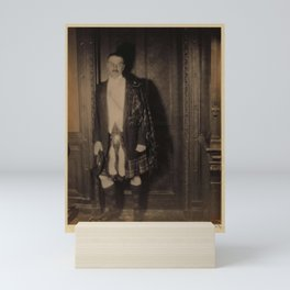 Doris Ulmann  (1882–1934), Man with mustache, in Scottish garb with kilt, standing in front of wood Mini Art Print