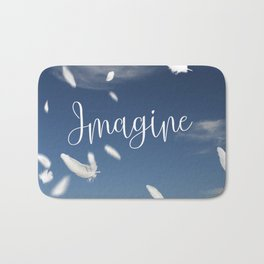 Imagine- Feathers and Typography on blue summersky Bath Mat