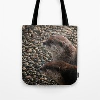 otters Tote Bags featuring Pair of Otters by Eleven Collective