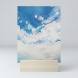 descending clouds Mini Art Print