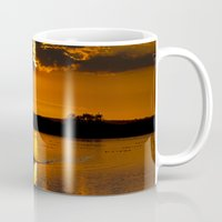 rowing Mugs featuring Rowing out of the sun by Traveling Journalist