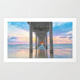 Ocean sunset through the pier Art Print