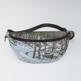 Snowy path in the woods on the Alps in winter Fanny Pack