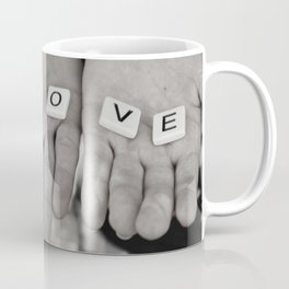 Love- a couple holding tiles spelling Coffee Mug
