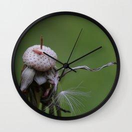 Resistance - Dandelion on green blurry background Wall Clock