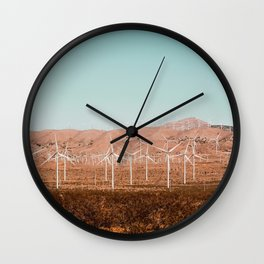 Wind turbine farm with blue sky in the desert at Kern County California USA Wall Clock