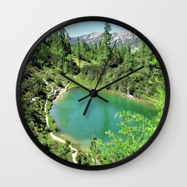 green lake in the mountains Wall Clock