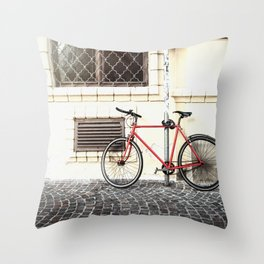 Bicycle standing on old street Throw Pillow