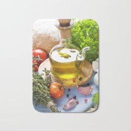 Bottle of Olive oil and condiments on blue napkin Bath Mat