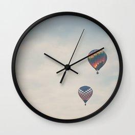 a pair of hot air balloons flying away ...  Wall Clock