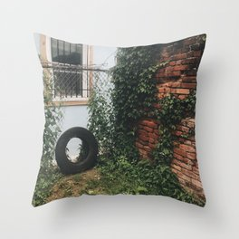 a tire, a yard Throw Pillow